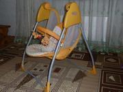 Продам детские электронные качели